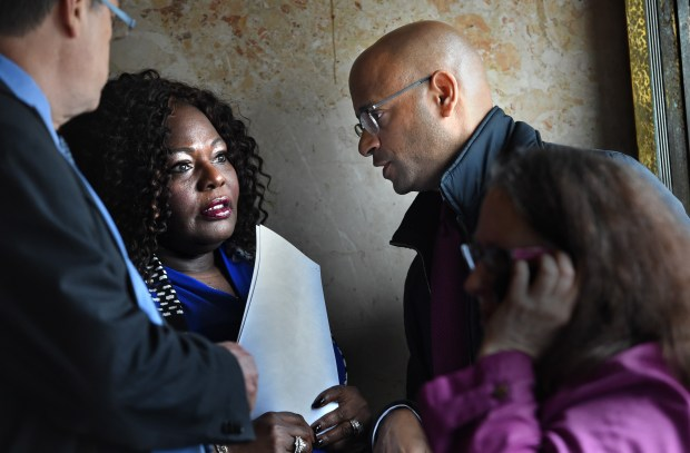 After a press conference, Kimberly Handy Jones, second from left, the mother of Cordale Handy, confers with civil rights attorney Andrew M. Stroth, right, and local counsel Darron Knutson, left, inside the doors of St. Paul City Hall Thursday, April 13, 2017. Cordale Handy was killed by St. Paul Police on March 15, 2017. Jones filed a federal lawsuit Wednesday. Jean Pieri / Pioneer Press