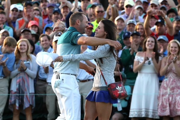 Sergio Garcia of Spain embraces fiancee Angela Akins in celebration after defeating Justin Rose (not pictured) of England on the first playoff hole during the final round of the 2017 Masters Tournament at Augusta National Golf Club on April 9, 2017 in Augusta, Georgia. (Photo by David Cannon/Getty Images)