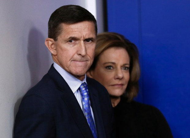 This Feb. 1, 2017, photo shows then National Security Adviser Michael Flynn, joined by K.T. McFarland, deputy national security adviser, during the daily news briefing at the White House, in Washington. President Donald Trump says his former national security adviser, Mike Flynn, is right to ask for immunity in exchange for talking about Russia. (Carolyn Kaster / Associated Press)