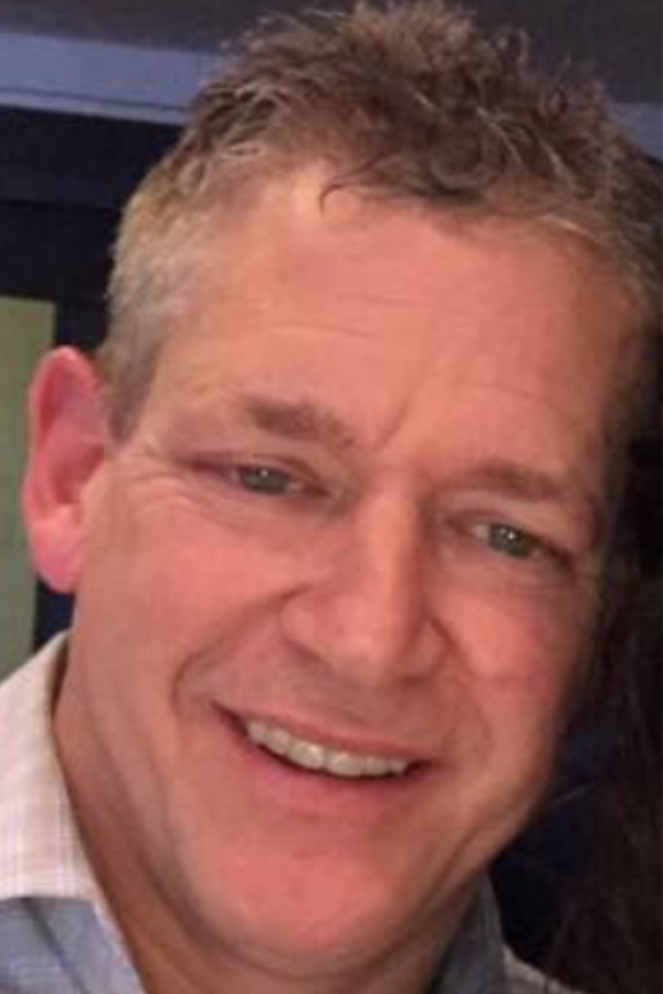 "Scott Goltz, 49, of Oak Grove, Minn., died unexpectedly on April 3, 2017 at the U.S. Bank Center, one of more than a dozen downtown St. Paul properties he managed. Goltz had recently been named president of Madison Equities, a St. Paul real estate company, and helped oversee the recent relighting of the iconic ""1st"" sign atop the First National Bank Building. (Photo courtesy of the Goltz family)."
