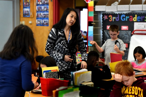Maria Le, a third grade teacher at Central Park Elementary School in Roseville, works with her class Friday, April 7, 2017. Le worked on a research project for Education Minnesota examining the state's teacher shortage and wants to see state and local leaders do more to retain existing teachers. Jean Pieri / Pioneer Press