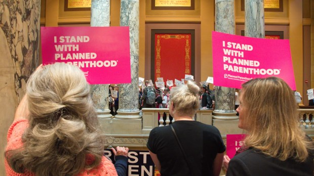 Opponents of abortion regulation legislation combined with those objecting to other Republican-sponsored provisions Thursday, May 4, 2017, in protesting Minnesota legislative actions. (Don Davis / Forum News Service)
