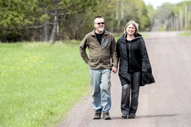 Suzanne Keithley-Myers enjoys walking with her husband William Myers near there home in Clover Valley. Keithley-Myers was diagnosed with an allergy is called alpha-gal after a tick bite. People that have alpha-gal allergies are allergic to carbohydrates that are found in red meat. (Clint Austin / Forum News Service)