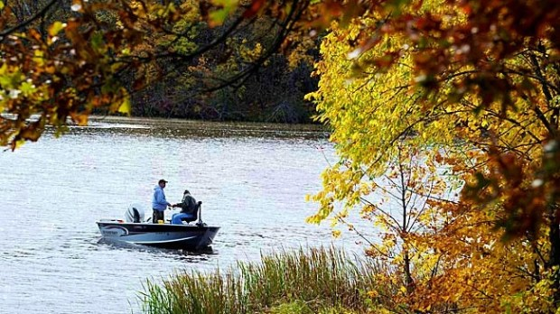 Two anglers fished off of Green's Point on the Mississippi River Monday, Sept 27, 2010 near Brainerd, MN. With the changing fall leaf color, the river corridor is prime place to view the changing autumn color. (AP Photo/Brainerd Dispatch, Steve Kohls)