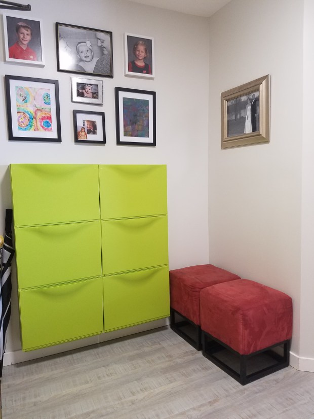 The entryway of the Bergs' renovated condo has storage at the ready. (Courtesy of Kati Berg)