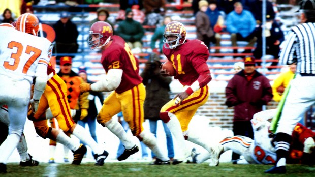 University of Minnesota running back Marion Barber Jr. (41) carries the ball against Illinois in an undated photograph. Barber, a running back at the University of Minnesota from 1977-81, will graduate from Minnesota at age 57 with a bachelor's degree in Youth Studies on Thursday, May 11, 2017, 36 years after he left the U as a New York Jets draft pick. Barber played six seasons with the New York Jets, and his son, Marion Barber III, played for the Gophers and Dallas Cowboys. (Courtesy of University of Minnesota Athletics)
