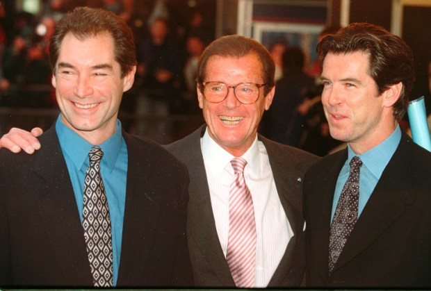 """In this Sunday, Nov. 17, 1996 photo, three of the actors who played James Bond, Timothy Dalton left, Roger Moore, center, and Pierce Brosnan, at a London cinema to celebrate the life of Albert R. """"Cubby"""" Broccoli, the American film producer behind seventeen Bond movies. In total, six actors have portrayed Bond officially. The upcoming """"Spectre"""" with Daniel Craig as 007 is the 24th in the series. Roger Moore's family said Tuesday May 23, 2017 that the former James Bond star has died after a short battle with cancer (AP Photo/Alastair Grant)"""