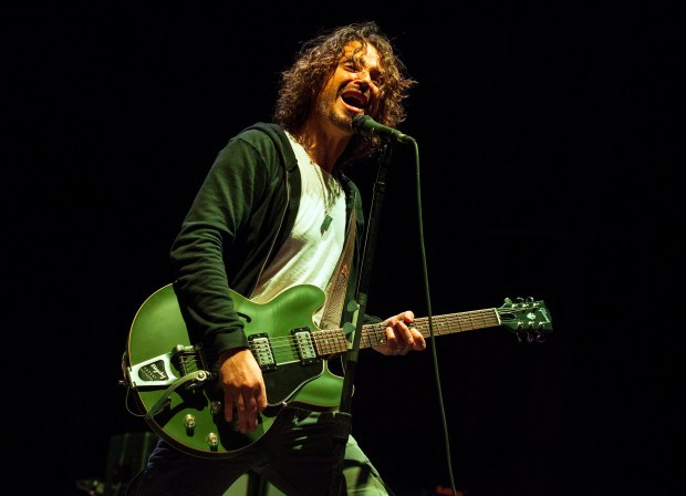 In this May 19, 2013 photo, Chris Cornell of Soundgarden performs at Rock on the Range in Columbus, Ohio. Cornell, 52, who gained fame as the lead singer of the bands Soundgarden and Audioslave, died at a hotel in Detroit and police said Thursday, May 18, 2017. (Photo by Barry Brecheisen/Invision/AP)