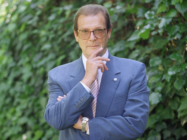 This is a April 22, 1996 photo of veteran British actor Roger Moore, poses for a portrait, in the Studio City section of Los Angeles. Roger Moore's family said Tuesday May 23, 2017 that the former James Bond star has died after a short battle with cancer (AP Photo/Chris Pizzello)