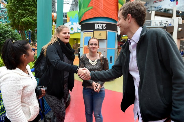 Chase Hamilton talks with three au pairs traveling the country and seeing America -- from left, Tremaine Naicker of South Africa, Elena Hassel and Larissa Schreiber of Germany -- at the Mall of America on Sunday, April 30, 2017. (Scott Takushi / Pioneer Press)