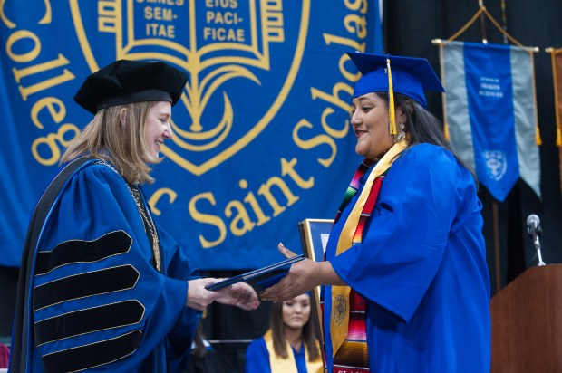 Gladys Reyes, right, of West St. Paul receives her diploma from President Colette McCarrick Geary during commencement ceremonies Saturday, May 13, 2017, at the College of St. Scholastica in Duluth. Reyes, 22, majored in health-information management. (David Ballard / Special to the Pioneer Press)