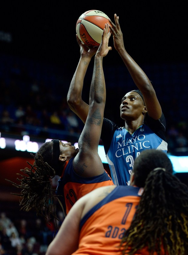 Minnesota Lynx's Sylvia Fowles is fouled by Connecticut Sun's Lynetta Kizer in the second half of a WNBA basketball game Friday, May 26, 2017, in Uncasville, Conn.. (Sean D. Elliot/The Day via AP)