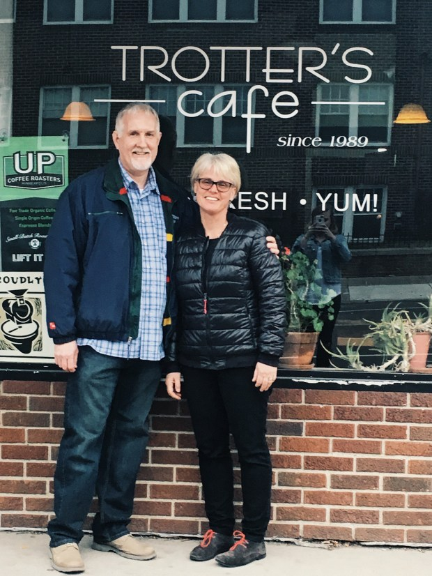 Eric and Kari Grittner in front of the Trotter's Cafe sign in April 2017. (Courtesy photo / Kari Grittner)