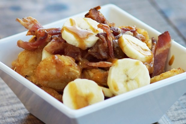 Memphis Totchos: Sliced bananas and sautéed bacon over tater tots, topped with peanut sauce. At Snack House, located in the Warner Coliseum, south concourse. (Courtesy of Minnesota State Fair)