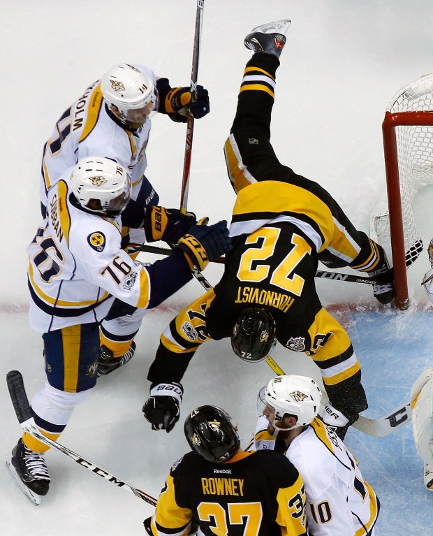 Nashville Predators' P.K. Subban (76) and Mattias Ekholm (14) check Pittsburgh Penguins' Patric Hornqvist (72) during the first period of Game 2 of the Stanley Cup Final, Wednesday, May 31, 2017, in Pittsburgh. (AP Photo/Gene J. Puskar)