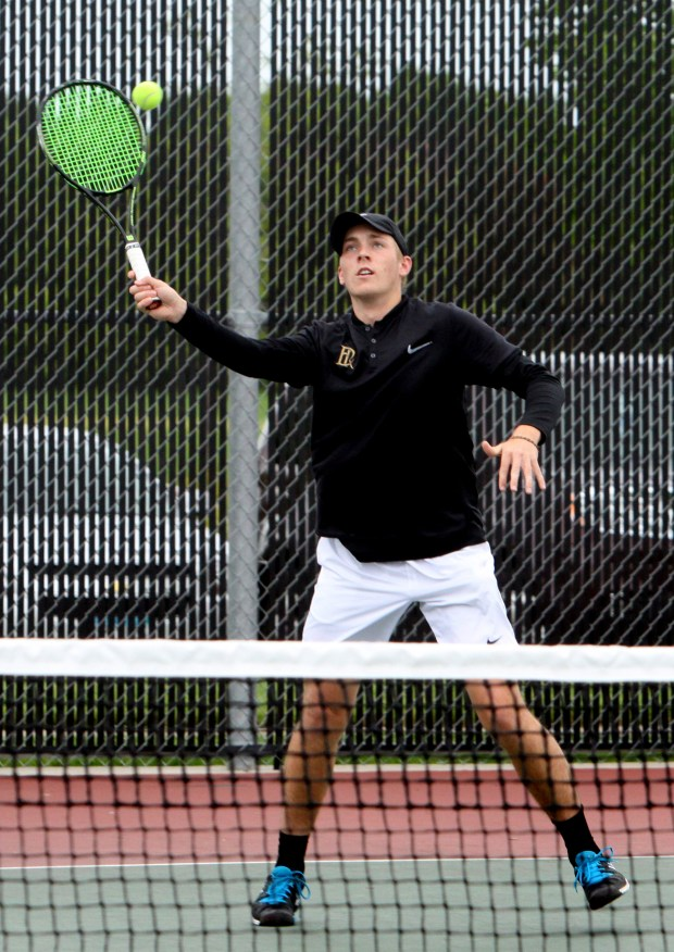 East Ridge's Ben van der Sman returns a volley during his match at No. 1 singles against Woodbury in the section tournament on May 18, 2017. (Blaze Fugina / Forum News Service)
