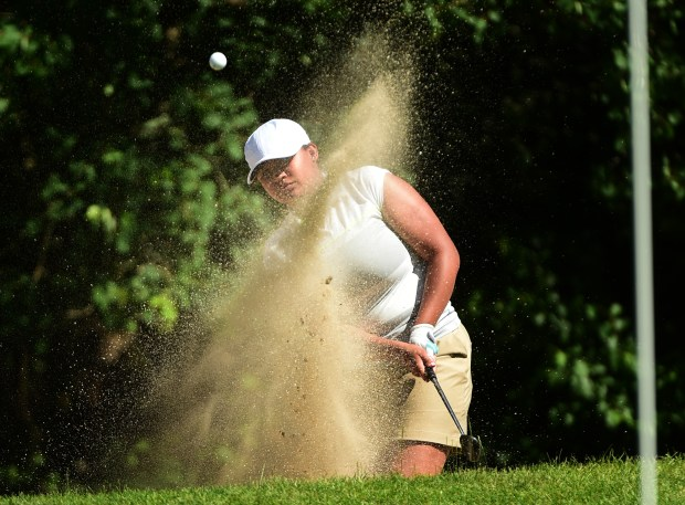 St. Paul Central's Iyanna Hutchinson hits out of a bunker during Class 3A competition in the State Girls' Golf Tournament  at Bunker Hills Golf Club in Coon Rapids on Wednesday, June 14, 2017. (Scott Takushi / Pioneer Press)