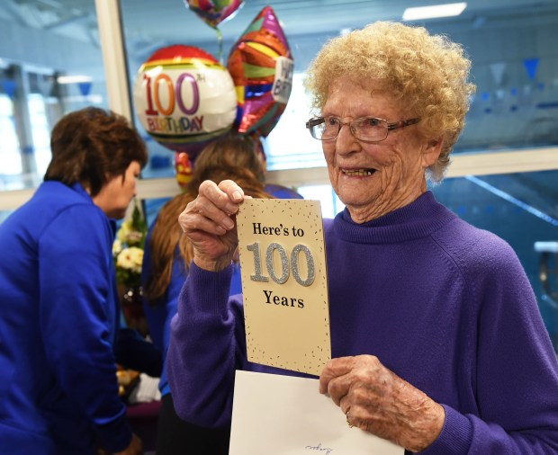 Virginia Milbert posed with a birthday card as she celebrated her 100th birthday at the West St. Paul YMCA, where she is an active member, June 26, 2017. Milbert works out every Monday, Wednesday and Friday. Following her workout she was presented with a cake and balloons, and took a ride in a stretch limo with her daughter Melane Milbert. (Scott Takushi / Pioneer Press)