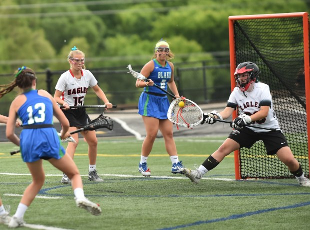 Eden Prairie Eagles goalie Emilie Bloyer catches a shot from The Blake School Bears forward Georgia Nolan in the second half of the Minnesota State High School League Girls Lacrosse Championship game at Chanhassen High School on Saturday. June 17, 2017. The Eden Prairie Eagles beat The Blake School Bears, 16-10. (John Autey / Special to the Pioneer Press)