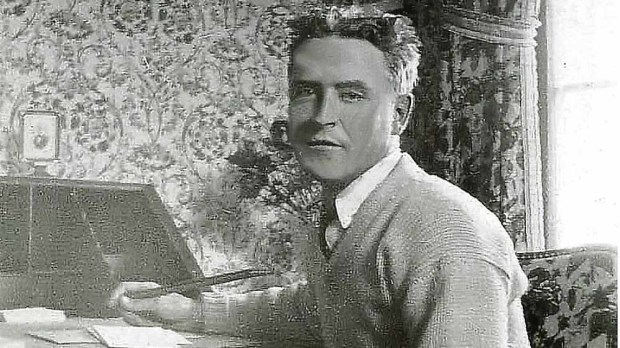 """F. Scott Fitzgerald in the third-floor bedroom of his parents' residence at 599 Summit Ave., where he wrote """"This Side of Paradise."""" (From the """"Sight Unseen"""" exhibit at the George Latimer Library in downtown St. Paul)"""