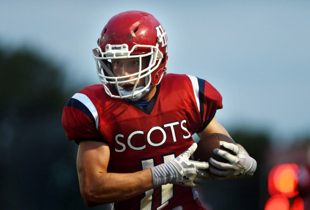 Highland Park's Josh Aune carries the ball during the second quarter of a football game against St. Croix Lutheran at Highland Park in St. Paul on Friday, September 4, 2015. Aune is the first St. Paul public school player to play on scholarship at Minnesota since Johnson running back Thomas Tapeh in 2003. (Holly Peterson / Pioneer Press)