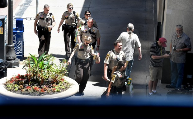 During the noon hour, Ramsey County deputies bring food into the Ramsey County Courthouse in St. Paul on Thursday, June 15, 2017, as jury deliberations continued Thursday in the trial of St. Anthony police officer Jeronimo Yanez, accused of fatally shooting Philando Castile during a July 2016 traffic stop in Falcon Heights. (Jean Pieri / Pioneer Press)