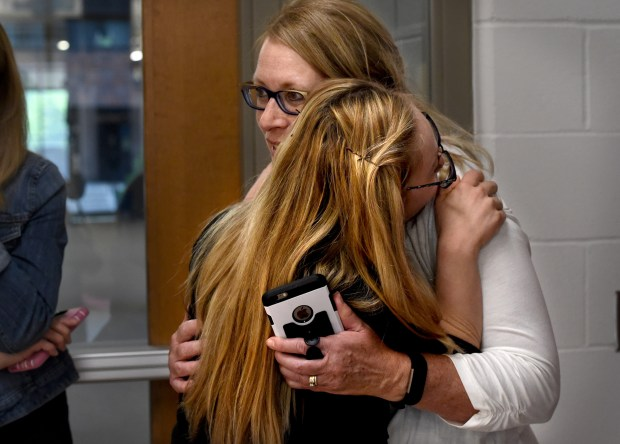 Mikayla Holmgren, gives a hug to her mom, Sandi Holmgren, after she finishes working with beauty pageant coach Wendi Russo at Bethel University in Arden Hills on Thursday, May 18, 2017. Holgren will compete as the first woman with Downs Syndrome in The Miss Minnesota USA pageant this year on Nov. 25-26 at the Ames Center in Burnsville. The winner will compete in the Miss USA pageant in Las Vegas next spring and could go on to be the next Miss Universe.Miss USA contestants are judged on interview, evening gown and swimsuit; there is no talent portion of the contest.Jean Pieri / Pioneer Press