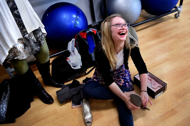 Mikayla Holmgren laughs as she puts on high heels before working with beauty pageant coach Wendi Russo at Bethel University in Arden Hills on Thursday, May 18, 2017 as her mother watches as she stands to the left. Jean Pieri / Pioneer Press
