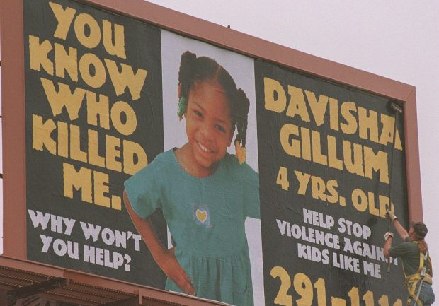A billboard goes up at the intersection of Lexington Parkway and University Avenue in St. Paul, about four blocks from where Davisha Gillum was killed last year when she and her mother apparently got caught in the middle of a gang shooting, in this February 1999 photograph. (Pioneer Press archives)