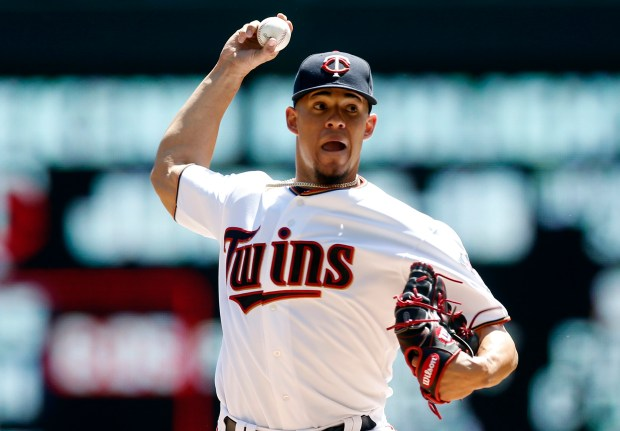 Minnesota Twins pitcher Jose Berrios throws against the Seattle Mariners in the first inning of a baseball game Thursday, June 15, 2017, in Minneapolis. (AP Photo/Jim Mone)