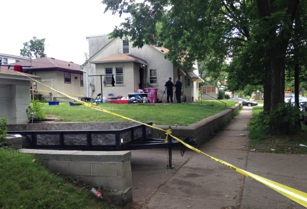 St. Paul police personnel on the scene in the backyard of a home in 200 block of West Maryland Avenue in St. Paul that was taped off Monday, June 19, 2017, after an early morning shooting that wounded three people, including a young girl. (Mara H. Gottfried / Pioneer Press)