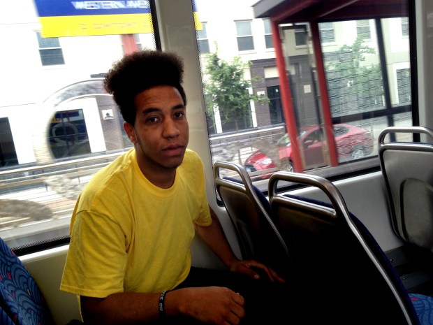 """Raymond Parker, 26, of Minneapolis, riding the Green Line light-rail train in St. Paul on Thursday, June 29, 2017, said he respects """"25 percent"""" of police officers, but those he favors are mostly retired. """"The 1990s cops, they would come give you baseball cards and throw the football around. What happened to those cops? It's just crazy nowadays. That was my picture of cops growing up. As far as trying to be a young black man in America, it's very discouraging. Sometimes police want to say hi to me, and I keep my head down and I keep walking ... especially if I feel the energy isn't positive -- I'm not going to say 'racist.' I'm going to say 'prejudiced.'"""" (Frederick Melo / Pioneer Press)"""
