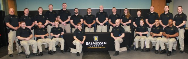 Fourth-grade teacher Sara Ross, kneeling in front, was selected by her classmates and her instructors to serve as one of the two team leaders in her law-enforcement skills course at Rasmussen College. Ross, 49, of Anoka, is hoping to transition from teacher to cop. (Photo by Mike Ardolf of Rasmussen College)
