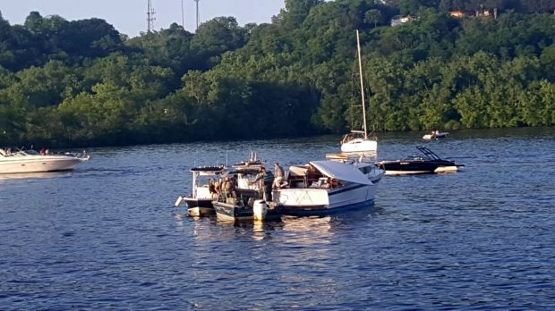 A boat, center right, is damaged Friday, June 2, 2017, after striking the Stillwater Lift Bridge. (Courtesy of Joan Beaver)