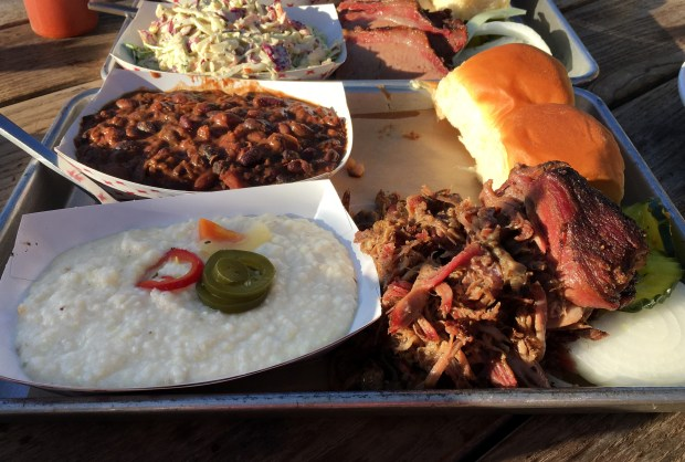 Pulled pork, foreground, and brisket, behind, and sides at Surly in Minneapolis on June 2, 2017. (Jess Fleming / Pioneer Press)