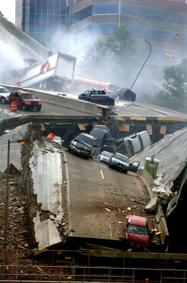 Vehicles are strewn on the fallen sections of the Interstate 35W bridge over the Mississippi River in Minneapolis after it collapsed during evening rush hour on Wednesday, Aug. 1, 2007. (Brandi Jade Thomas / Pioneer Press)
