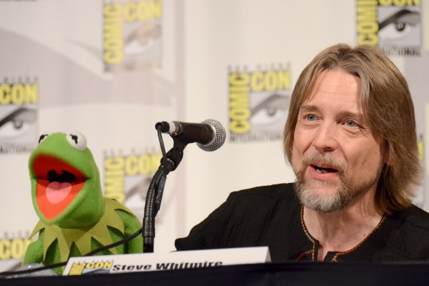 """Kermit the Frog, left, and puppeteer Steve Whitmire attend """"The Muppets"""" panel on day 3 of Comic-Con International on Saturday, July 11, 2015, in San Diego. (Photo by Tonya Wise/Invision/AP)"""