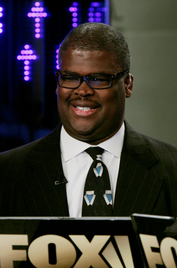 """In this April 11, 2011 photo, Charles Payne, of the Fox Business Network, appears on """"Varney & Co.,"""" in New York. Payne has been suspended after reportedly being accused of sexual harassment. The network said Thursday, July 6, 2017, it suspended """"Making Money"""" anchor Payne pending an investigation, but didn't provide any details. (AP Photo/Richard Drew)"""