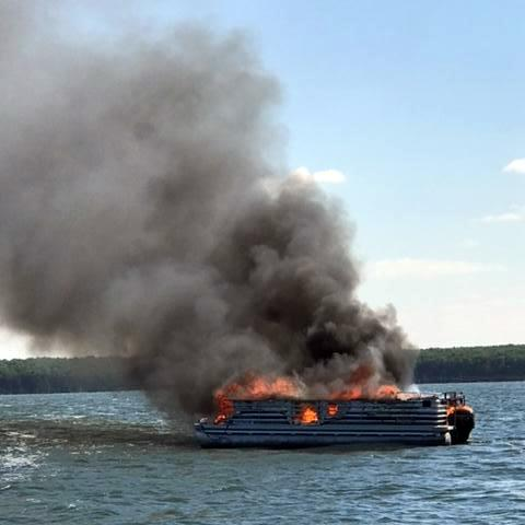 David Gerszewski's pontoon goes up in flames Saturday evening on Devils Lake after it caught fire. About 30 boats came to the rescue of the Minto, N.D., man, his daughter and the family dog after they jumped into the water. (Courtesy photo via Forum News Service)