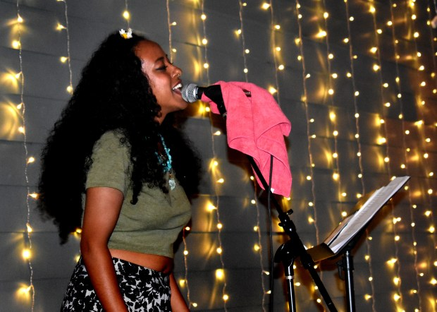 "For a story about artists honoring Philando Castile, who was killed on July 6, 2016 by St. Anthony police officer Jeronimo Yanez during a traffic stop in Falcon Heights -- Lula Saleh, an Ethiopian-Eritrean poet and singer-songwriter, performs at the Party with the People's Movement Center event in Minneapolis on July 8, 2017. The week of the Philando Castile shooting, Saleh wrote a song titled ""Stardust"" with the goal of uplifting those healing through their grief. (Selam Berhea / Pioneer Press)"