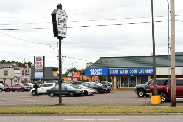 Giant Wash and the Lamplighter Lounge in St. Paul at the intersection of Larpenteur Avenue and Rice Street, where three cities come together: St. Paul, Roseville and Maplewood, July 13, 2017. (Scott Takushi / Pioneer Press)