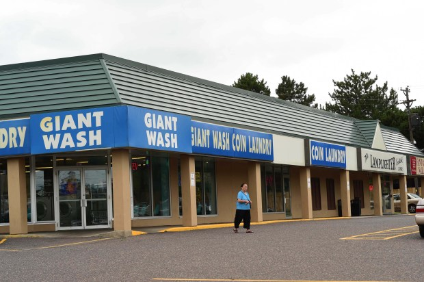 Giant Wash and the Lamplighter Lounge in St. Pau at the intersection of Larpenteur Avenue and Rice Street, where three cities come together: St. Paul, Roseville and Maplewood, July 13, 2017. (Scott Takushi / Pioneer Press)