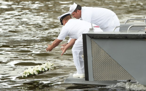 Nearly 10 years since the I-35W bridge over the Mississippi River in Minneapolis collapsed, Navy divers who worked at the scene for weeks after the collapse laid a memorial wreath in the water, on Tuesday, July 18, 2017. At left is Chief Navy Diver Noah Gottesman, left, and Navy Diver 1st Class Brian Bennett. (Scott Takushi / Pioneer Press)