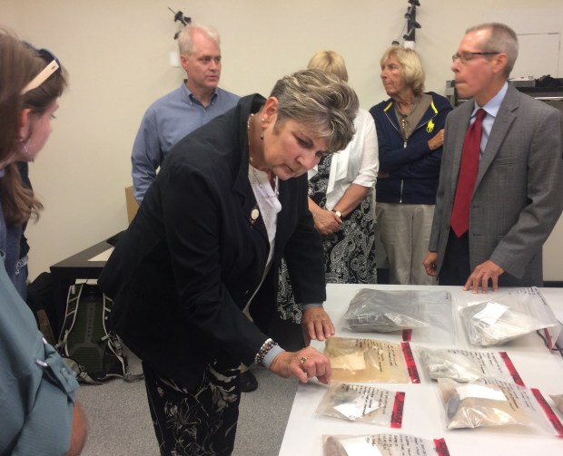 Sgt. James Hubert's niece Bonnie Lou Dunphy of Duluth looks at Hubert's personal effects at an event at the Minnesota History Center. Hubert was killed in the Battle of Tarawa in World War 2 and his remains were found in 2015. (Photo credit: Sophie Carson, Pioneer Press)