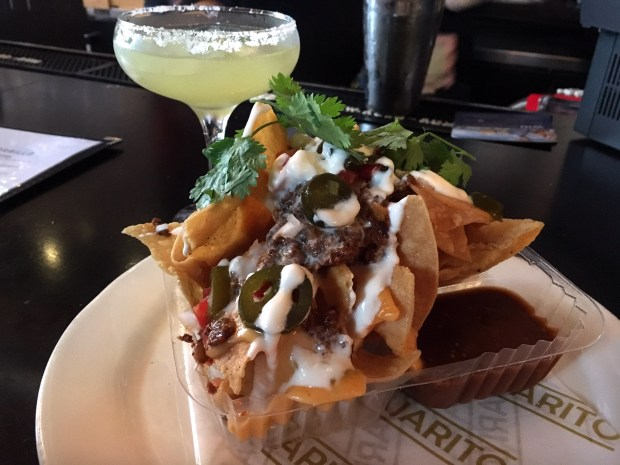 July 2017 photo of Club nachos and a habanero cilantro margarita at Pajarito in St. Paul, part of a happy hour roundup for the July 26 Eat cover. (Jess Fleming / Pioneer Press)