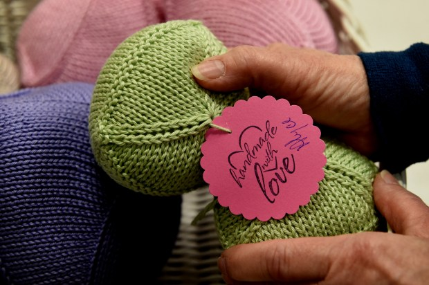 Alyce Brekke, a registered nurse at Lakeview Hospital, shows Knitted Knockers -- breast prostheses for women undergoing mastectomies in Stillwater Thursday, June 29, 2017. Brekke and friends have made more than 100. The colorful and light cotton breasts - stuffed with microfiber filing - are a user-friendly alternative to silicone breast prostheses which can be hot, heavy and sticky. She recently received a $1,000 grant from Lakeview Hospital Foundation to purchase yarn for the project. (Jean Pieri / Pioneer Press)