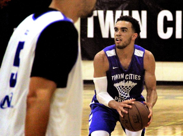 Tyus Jones sizes up a jump shot during Team Jones' 99-91 win over Finer Way Inc. in a Twin Cities Pro-Am game at DeLaSalle High School in Minneapolis on Monday, July 10, 2017. Jones, a Timberwolves guard, had to wait until July to play in the pro-am, per NBA rules. (Jace Frederick / Pioneer Press)