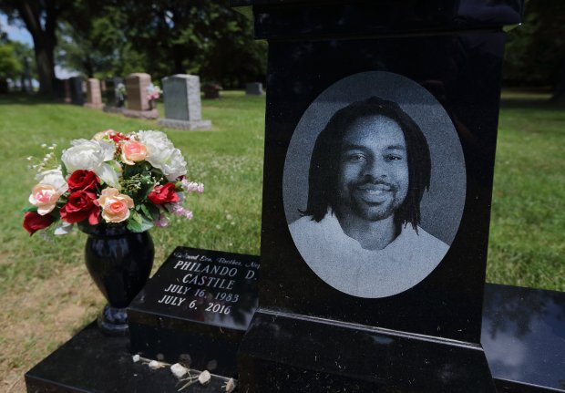 The grave of Philando Castile at Calvary Cemetery in St. Louis on the one-year anniversary of his death on Thursday, July 6, 2017. Minnesota police officer Jeronimo Yanez fatally shot and killed Castile during a traffic stop in 2016. During the traffic stop Castile, a licensed gun owner, volunteered that he had a gun and moments later officer Yanez fatally shot Castile, who was seat belted in his car. Yanez was charged with manslaughter in Castile's death but was found not guilty by a jury. (David Carson/St. Louis Post-Dispatch/TNS)