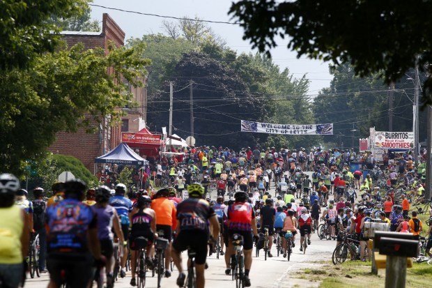 Riders roll into Letts, Iowa, during RAGBRAI on Saturday, July 30, 2016. (Des Moines Register)