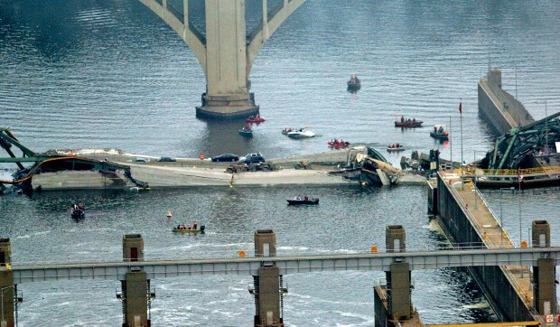 A scene from Aug. 1, 2007, shows rescue crews working in the water alongside sections of the Interstate 35W bridge after it collapsed into the Mississippi River in Minneapolis during evening rush hour. (Sherri LaRose-Chiglo / Pioneer Press)